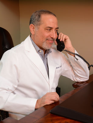 Dr. Morris Hasson talking about his practice on the phone